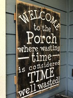 porch paint ideas Welcome to the porch. where wasting time is considered time well wasted. painted black on rustic fence wood with white painted words. Old Fence Wood, Rustic Fence, Wood Fences, Rustic Porches, Farmhouse Front Porches, Rustic Cabins, Cedar Fence, Log Cabins, Fencing