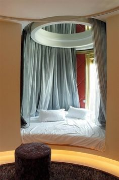 for classroom reading nook...circle hung from ceiling wrapped with fabric then tack to the side somehow