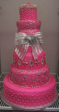pink wedding cake  love it, I would make the bow out of fondant too and smaller. the big bow makes this cake look too busy