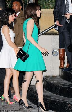 Nice pins! Zooey Deschanel wore a pair of sexy bow ties on her stockings while out and about in Hollywood on Saturday night