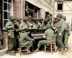 """Soldiers of the 2nd Armored Division sing""""Go to Town"""" in Barenton, France, 1944. -"""