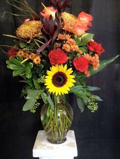 Aren't sunflowers, carnations and roses gorgeous together? We certainly think so!