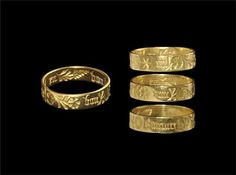 Medieval Gold 'Eu Bon Amour' Posy Ring.Circa 14th century AD. A gold flat-section posy ring with star and flower decoration to the outer face between the texts 'eu bon amour' (for good love); on the inner face floral decoration and the text 'eu bon au'. Gold, 2.74 grams, 19 mm (approximate size British P, USA 7 1/2, Europe 16.0, Japan 15). Payn collection, acquired in the 1950's.