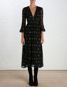 Zimmermann Master Dove Dress, from our Spring 16 collection, in black silk georgette with dove print. Midi length V neck dress with fitted waistband, blouson sleeve and buttoned cuff. Circle lace trim at neckline and hem. Centre back invisible zip closure.