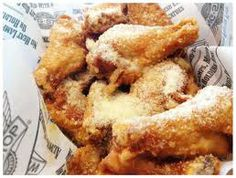 Wing Stop Parm Wings!(: 1/4 cup butter, melted 1 teaspoon garlic powder 1/2 teaspoon onion salt 1/4 teaspoon black pepper, freshly ground 1/2 cup parmesan cheese, grated 24 chicken wings, nude, baked (or fried per your desire)  1) In a small glass bowl, melt butter in microwave. 2) Whisk into butter the garlic powder, onion salt and pepper. 3)Arrange hot, fresh-baked nude wings on a serving platter and drizzle with butter mixture. 4) Top with parmesan cheese and serve immediately.
