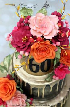 Hi all, happy to share here a Black & Gold three tier cake that I designed for a 60th birthday party. I used Orange, Peach, Deep Pink and Maroon theme for the sugar flowers to go with the Black & Gold covering. I was pretty pleased with...