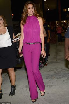 Still stunning! Cindy Crawford showed off her svelte shape in a magenta ensemble as she discussed her book Becoming at Miami Dada College in Miami, Florida on Monday