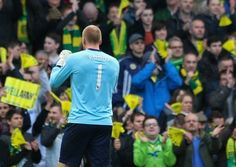 John Ruddy celebrates with Norwich City's fans after a 2-0 Premier League win over Sunderland eases their relegation fears.