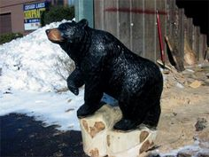 chainsaw wood carving.....The bear is just amazing ! Love it !