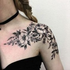 Blackwork florals on shoulder by Vlada Shevchenko