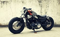 Welcome to Cafe Racer Design! We focus solely on showcasing the design of Cafe Racer Motorcycles. Cafe Racer is a term used for a type of motorcycle and the cyclists who ride them! Sportster Cafe Racer, Hd Sportster, Bobber Motorcycle, Cool Motorcycles, Vintage Motorcycles, Bobber Bikes, Harley Bobber, Bobber Chopper, Motorcycle Style