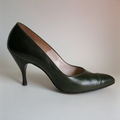 Early 1960s pointy toed, olive green leather high heel stilettos. Description from etsy.com. I searched for this on bing.com/images