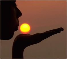 GIF.  the sun  move on her hand, as if it was her blowing it,