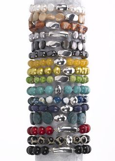 Simon Sebbag; ITEM BRACELETS  Stones:  Pearl  Mother of Pearl  Brown Shell  Grey Pearl  Black Mother of Pearl  Hematite  Yellow Jade  Yellow Pearl  Green Turquoise  Turquoise  Blue Fire Agate  Sapphire Jade  Blue Apatite  Red Coral  Tortoise Agate  Black Onyx