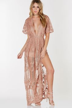 A magnificent mesh maxi dress with intricate crochet detailing throughout. Flowy short sleeves with an elegant wide V-neckline. Hidden zip back closure with a romper lining attached.