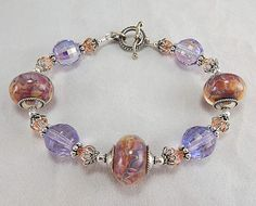 Purple and peach bracelet lampwork beads by Jerri Kennerly