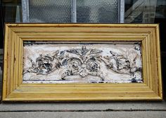 Decorative tin salvaged from Philadelphia, circa 1880's, framed with salvaged window and door trim from Southern Accents Architectural Antiques - www.sa1969.com    Showroom Assistance:  Phone: 1 877-737-0554  Email:info@sa1969.com