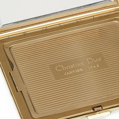 1958 - Launch of first Dior powder compact
