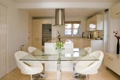 Inspiration Ideas for Creating Stunning Designing A Basement Apartment: Luxury Basement Apartment Kitchen Ideas With Stunning White Kitchen Cabinets Feats Charming Silver Vents And Elegant Glass Dining Table Set Also Wonderful Gloss Flooring Ideas ~ bubaraba.com Apartment Inspiration