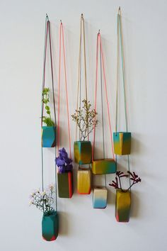 How wonderful do these hanging planters planters look? Hung on different coloured strings to make a living wall of tiny plants it has the effect of bringing nature indoors - albeit in a small way.thebestlittleapartment: hanging planters via AFNOLET. Best Decor, Hanging Planters, Diy Hanging, Wall Planters, Succulent Planters, Clay Planter, Hanging Herbs, Hanging Succulents, Clay Pots