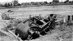 The remains of a car and debris on the banks of the Los Angeles River after the flood of 1938. There have been eight major floods in the Valley since 1861, but the 1938 Los Angeles River Flood was one the worst. Rains lasted for 3 days and the Big Tujunga Wash levee broke,  shutting down utilities, washing out bridges, and destroying many buildings. It took 30 days and approximately $60,000.00 to clean-up the storm debris. San Fernando Valley History Digital Library.History Digital Library.
