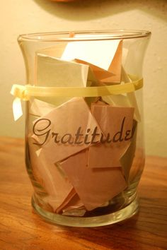 Write down one thing you are grateful for per day and place it in a clear vase or jar. Review as needed. :-)  instead of this... you could at the wedding have people write down encouragement, or fav. scriptures and marriage tips. :)