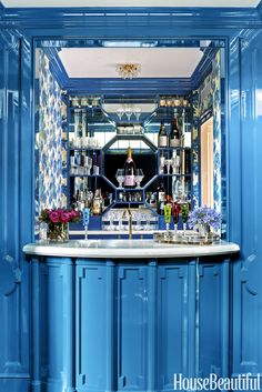 The mirrored bar — lacquered in Bailey McCarthy Peppermint Bliss Bar w Mirrored backsplash and octagon fret work. Benjamin Moore's Summer Nights, embellished with Sandberg's Raphaël wallpaper, and topped with a white-onyx counter Most Popular Paint Colors, Library Bar, Library Design, Biscuit Home, Built In Bar, Built Ins, Blue Bar, Enchanted Home, Interior Design Business