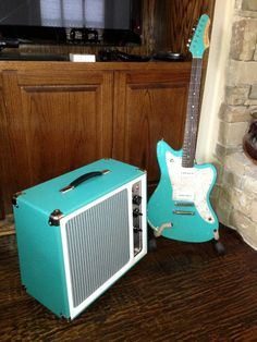 A Turquoise Falcon along with a Fano Guitars JM6 in Tone King Turquoise