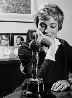Julie Andrews gazes lovingly at her Academy Award, atth she won for 1965 Best Actress in Mary Poppins..