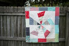 Surprise! I have a free quilt pattern to share with you. Call it a  Valentine's Day gift. :)  Actually the gift was mine a month ago when Fat Quarter Shop emailed and  offered me a Jolly Bar of my choice if I would just make something cute  with it. What do you think?