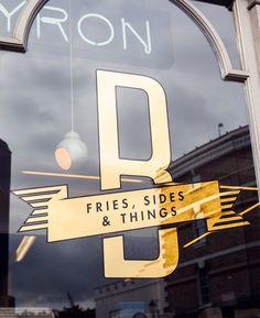 Byron signage designed by charlie smith design. gold vinyl signage on shop window House Paint Exterior, Exterior Paint Colors, Paint Colors For Home, Exterior Design, Wayfinding Signage, Signage Design, Retail Signage, Calgary, Mid Century Exterior