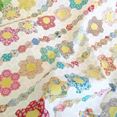 "**not my work** My mother-in-law's current hand piecing project. 3/4"" hexies + Liberty #libertyfabric"