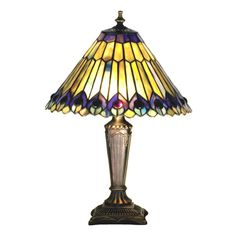 Glowing Amethyst Jewels Circle Stylized Peacock Feathers Made Of Amber, Jade And Amethyst Streaked Plum Colored Art Glass With Cobalt And Plum Accents. Each Piece Of Stained Glass In This Tiffany Style Shade Is Hand Cut And Wrapped In Copper Foil. This Versatile Favorite Is A Match To Many Decorative Styles. The Accent Lamp Base Is Hand Painted In A Beautiful Mahogany Bronze Finish.