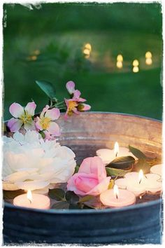 ambiance..outdoor dining centerpiece... Float fresh flowers and candles in a waterproof container