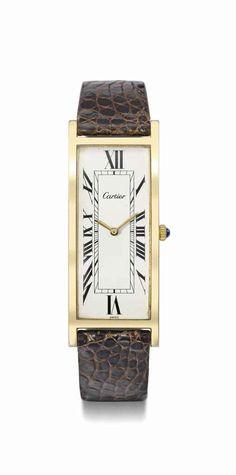 Cartier. A fine and rare 18K gold plated rectangular curved wristwatch,  circa 1960   d2a8e714e9