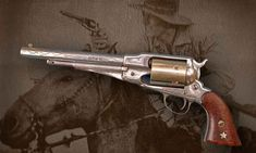 John Wayne's first movie side arm... New Model 1861 Remington Army revolver, with its distinctive diamond cut pattern on each side of the octagonal barrel. It was packed by a young Duke in the 1930 epic film The Big Trail.