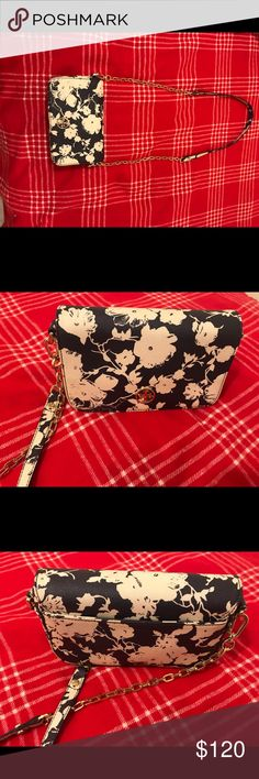 Tory Burch Floral Leather Robinson Cross Body Bag White and blue  Great conditioned (used maybe 5 times at max)  If a video or more pictures are requested (not a problem at all!) Tory Burch Bags Crossbody Bags