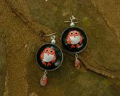 Upcycled Kingfisher domed bottle cap earrings with hand-painted beads & backs. $25.00, via Etsy.