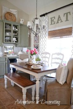 White Kitchen table with Stained Top. Do you like the use of the bench and two different types of chairs.