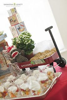 Love the use of the Radio Flyer (not the color scheme, though!).  Would be better with very old, beat-up RF or even wheel barrel for drinks in bottles filled w ice OR party favor holder?