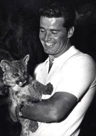 James Garner - no I don't know why he's holding this cub