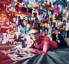Er, I think Tyler likes 1D... Look at the posters!   Shout out to Tyler Oakley, best freakin YouTuber EVER!!!