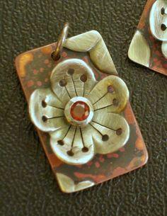 Cherry Blossom Charm - Japan Aid - Sterling Silver and Garnet. $45.00, via Etsy.
