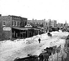 "The great blizzard of 1886 (above), followed by years of droughts, drove many Kansas farmers out of the state, some of whose wagons bore the slogan ""In God We Trusted, In Kansas We Busted."""