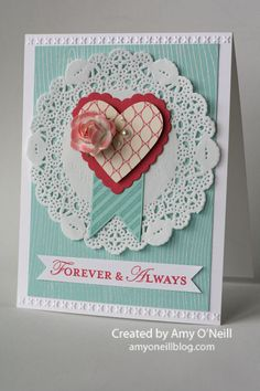 Stamps: Hearts a Flutter, Loving Thoughts, Woodgrain Ink: Pool Party, Primrose Petals, Versamark Paper: Pool Party, Whisper White, Primrose Petals,More Amore Specialty dsp Embellishments: Hearts a Flutter framelits, Needlepoint Borders embossing folder, Tea Lace Paper Doilies, White Stampin' Emboss Powder, Pearl Basic Jewels, Artisan Embellishments Kit, Full Heart Punch