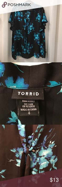 Black blouse with blue flowers. Black blouse with blue flowers.  Nice work blouse. torrid Tops Blouses