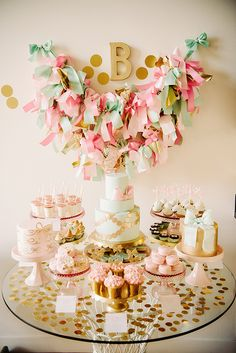 cute dessert display. loving the bow theme, the confetti and the overall color palette!