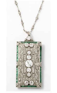 An Art Deco platinum emerald diamond brooche/pendant