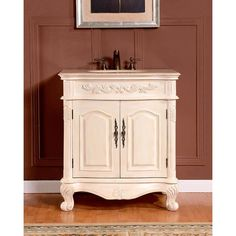 With elegant carved accents and antique brass hardware, this Crema Marfil bathroom vanity is sure to add a touch of refinement to your home. The solid wood structure finished in white oak features turned feet and a classic design.