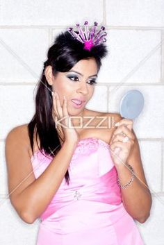 young female with mouth open looking in a hand mirror. - View of a attractive young female with mouth open looking in a hand mirror, Model: Sabrina Ramkissoon